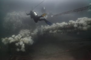Divers exploring the A.C.E. in 2010